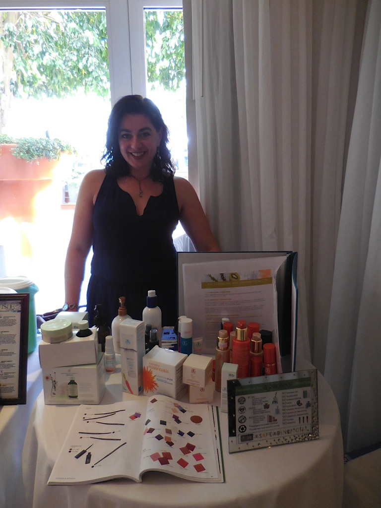 Deborah from Arbonne welcomes attendees with a nice smile