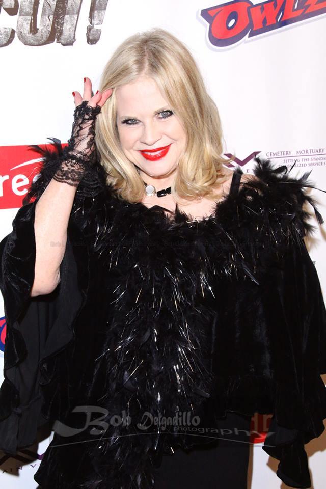 Actress Suze-Lanier Bramlett in a feathery ensemble