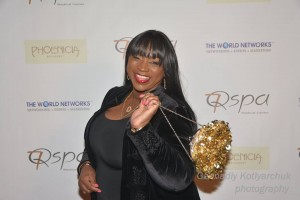 Gold Glamour...Publicist Cynthia Busby struts through the red carpet with her gold bag. Photo courtesy of Gennadiy Kotlyarchuk