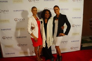 Popular radio show host Mother Love is flanked by beautiful runway models and red carpet interviewers Erin and Desiree Green. Photo courtesy of The Experience