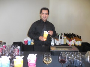 Bartender Juan Carlos pours some amazing Nuvino wine for attendees