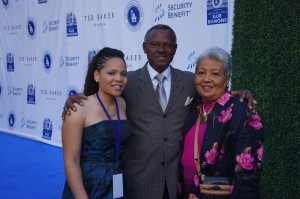 DeMira Pierre with Manny Mota and his wife Margarita on the blue carpet