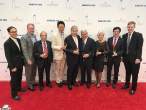 Executives from Korean Airlines on the red carpet with YH Cho center. Photo by EXPERIENCE MAGAZINE staff photographer